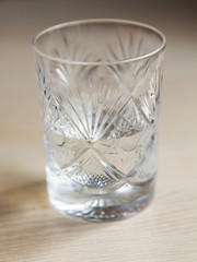 Crystal glass with water on a table