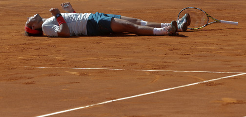 Nadal of Spain celebrates his victory over Wawrinka of Switzerland at the end of their men's singles final match at the Madrid Open tennis tournament in Madrid