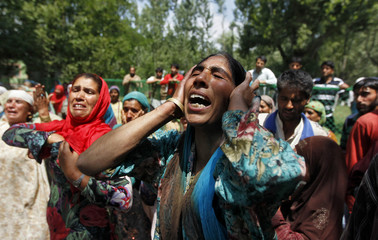 Kashmiri women mourn during the funeral of Ganaie in the north of Srinagar