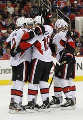 Ottawa Senators celebrate teammate Jason Spezza's goal against the Carolina Hurricanes during the second period of their NHL hockey game in Raleigh