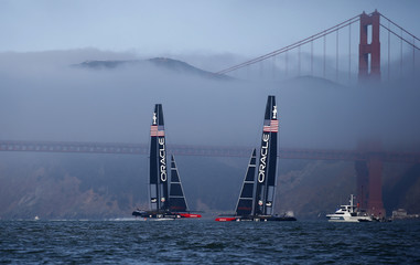 The two Oracle Team USA AC72 catamarans sail near the Golden Gate Bridge as they get ready for a practice race on San Francisco Bay