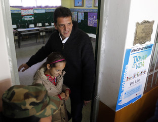 Massa, major of Buenos Aires' Tigre town, leaves after voting at a polling station in Tigre