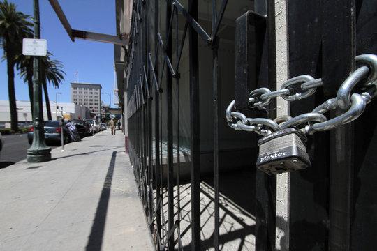 Shuttered and padlocked businesses line Main Street in Stockton, California