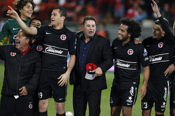 Tijuana players celebrate after winning the Mexican league championship final soccer match against Toluca in Toluca