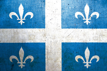 Flag of Quebec, Canada, with an old, vintage metal texture