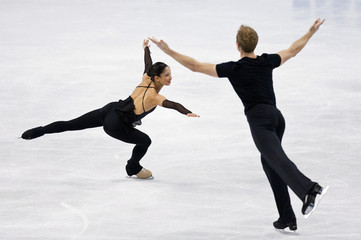 Ladwig skates with his partner Evora in their pairs practice session during the U.S. Figure Skating Championships in Greensboro