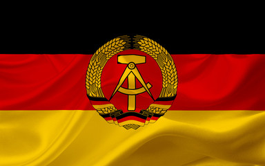 Flag of German Democratic Republic, with waving fabric texture Wall mural