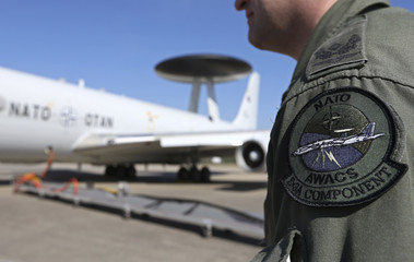 The patch of the NATO AWACS aircraft is seen attached to the uniform of an officer before boarding for a surveillance flight over Romania from the AWACS air base in Geilenkirchen near the German-Dutch border