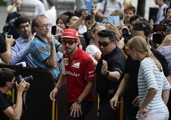 Ferrari Formula One driver Alonso arrives at a promotional event before Singapore F1 Grand Prix in Singapore