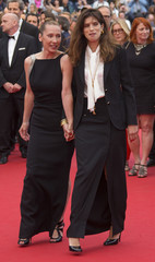 """Director Maiwenn and actress Emmanuelle Bercot, cast member of the film """"Mon roi"""", pose on the red carpet as they arrive at the closing ceremony of the 68th Cannes Film Festival in Cannes"""