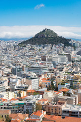 Summer cityscape of Athens with Lycabettus Hill, Greece