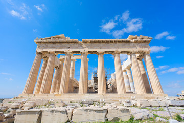 facade of Parthenon temple over bright blue sky background, Acropolis hill, Athens Greece
