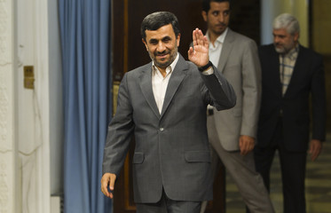 Iranian President Ahmadinejad arrives for an official meeting in Tehran