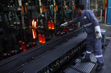 A worker checks the production of wine bottles at Saverglass' plant in Ras Al Khaimah