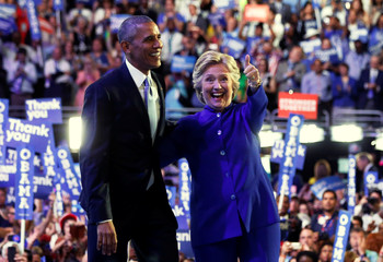 Democratic presidential nominee Hillary Clinton joins U.S. President Barack Obama onstage after his remarks on the third night of the Democratic National Convention in Philadelphia, Pennsylvania