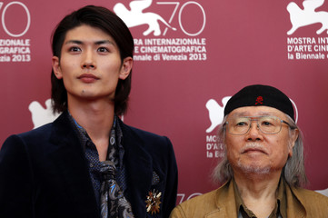 Actor Haruma Miura and author of several anime and manga series Leiji Matsumoto pose during a photocall in Venice