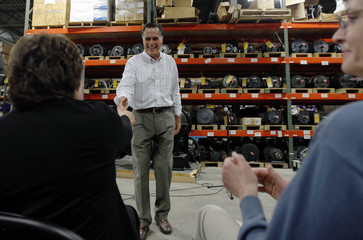 Republican presidential candidate Mitt Romney shakes hands with employees during a visit to Stanley Elevators in Merrimack