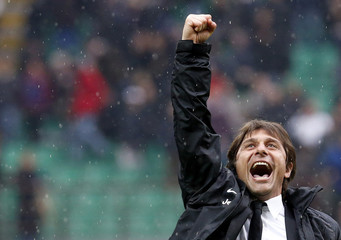 Juventus' coach Antonio Conte celebrates their win against Inter Milan at the end of the Italian Serie A soccer match in Milan