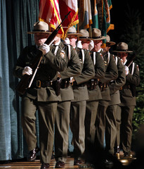 An honor guard of U.S. National Park rangers march flags to the stage during a memorial service for slain ranger Anderson at Pacific Lutheran University in Tacoma