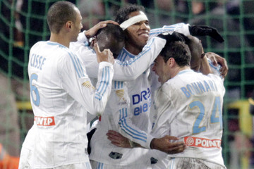 Olympique Marseille players celebrate after their victory against Toulouse in the French League Cup soccer match in Toulouse