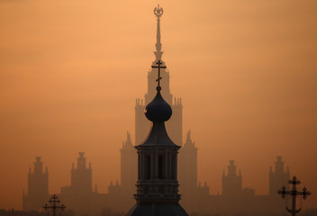 A view shows the main building of the Lomonosov Moscow State University behind an Orthodox church in Moscow