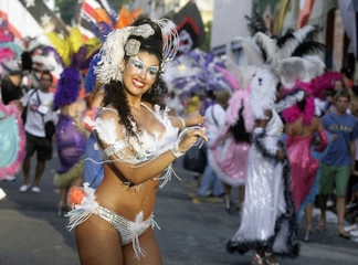 """Members of a """"comparsa"""", a carnival band, participate in the """"llamadas"""" parade in Montevideo"""