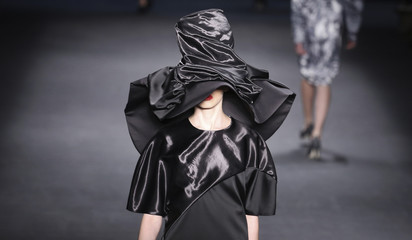 Model presents a creation from the Fernanda Yamamoto 2014 winter collection during Sao Paulo Fashion Week