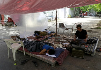 Striking students rest under an improvised tent at the Film and Television Institute of India (FTII) in Pune