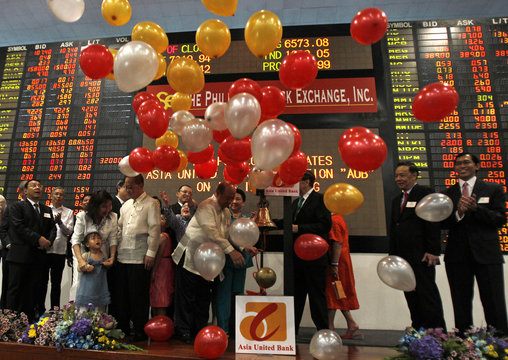Balloons fall down after Ng, Asia United Bank chairman, led the ceremonial ringing of the bell at the Philippine Stock Exchange in Makati city, metro Manila