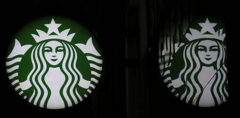 A Starbucks logo is seen at a Starbucks coffee shop in Vienna