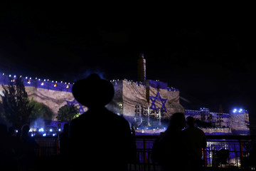 Israel national flag is projected on the wall near David Tower at the Old City of Jerusalem