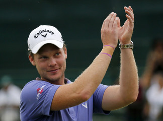 Danny Willett of England acknowledges applause after winning the Nedbank Challenge at Sun City