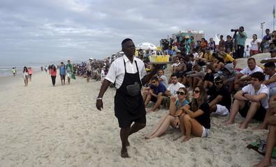 "A man sells ""Caipirinha"" before the finals of the men´s World Surf League (WSL) Rio Pro championship in Rio de Janeiro"