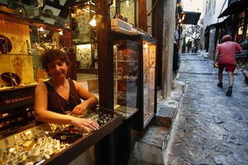 Tasia Livieratou stands in her silverware and jewlery workshop shop inside the medieval castle of Monemvasia