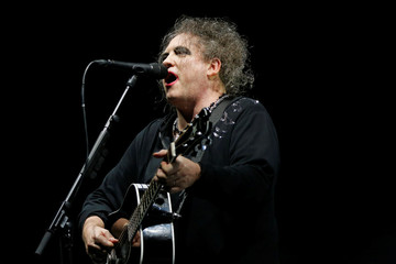 British singer Robert Smith performs on stage during a concert of the band The Cure at the AccorHotels Arena in Paris