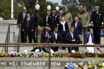 U. S. Secretary of State Hillary Rodham Clinton, U.S. Defense Secretary Leon Panetta, Australian Defence Minister Stephen Smith and Australian Foreign Minister Bob Carr walk to a wreath-laying ceremony at the State War Memorial in Kings Park in Perth