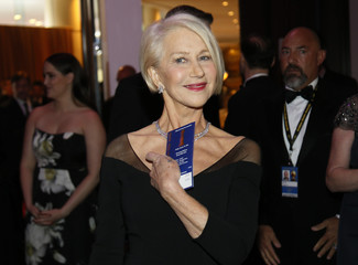 Actress Helen Mirren shows off her ticket at the 73rd Golden Globe Awards in Beverly Hills