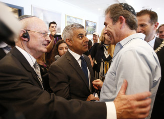 London's newly elected mayor Sadiq Khan meets guests at a holocaust commemoration ceremony held at a rugby stadium in north London