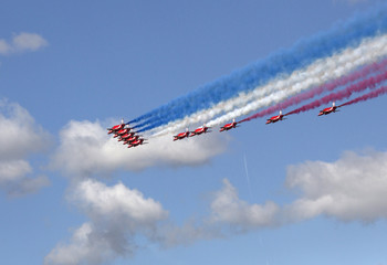The Red Arrows display team perform a fly past to officially open the 2014 Farnborough International Airshow in Farnborough