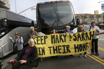Demonstrators block the path of a Google commuter bus in the Mission District in San Francisco, California