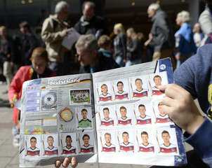 A boy presents his Panini soccer World Cup collection stickers during an exchange meeting in Hamburg
