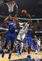 Memphis Grizzlies guard Conley shoots against Los Angeles Clippers center Jordan and guard Billups during first half of NBA basketball action in Memphis