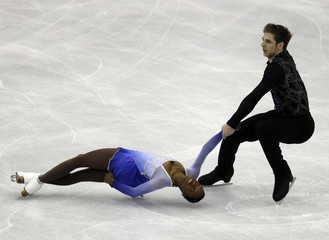 James and Cipres of France perform during the pairs free skating event at the ISU World Figure Skating Championships in Nice