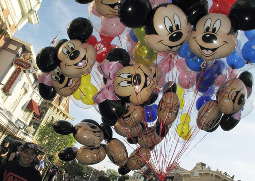 Balloons of Mickey Mouse are carried down main street at Disneyland in Anaheim