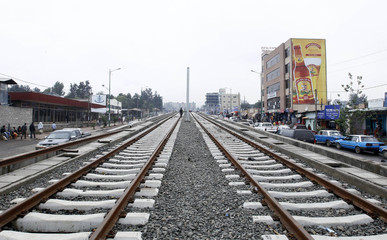 A man walks along the electrified light rail-transit construction in Ethiopia's capital Addis Ababa