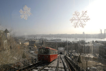 A view of Russia's far eastern city of Vladivostok, from a cabin of a funicular train with festive decorative snowflakes on its windows