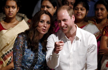 Britain's Prince William and his wife Catherine, the Duchess of Cambridge, talks as they watch dancers perform Bihu dance, a traditional folk dance, at a tourist lodge in Kaziranga