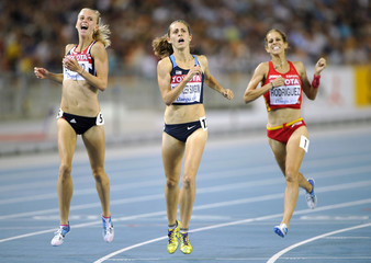 Simpson leads across the finish line to win the women's 1,500 metres final at the IAAF World Championships in Daegu
