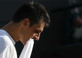 Bernard Tomic of Australia reacts during his men's singles tennis match against Tomas Berdych of the Czech Republic at the Wimbledon Tennis Championships, in London