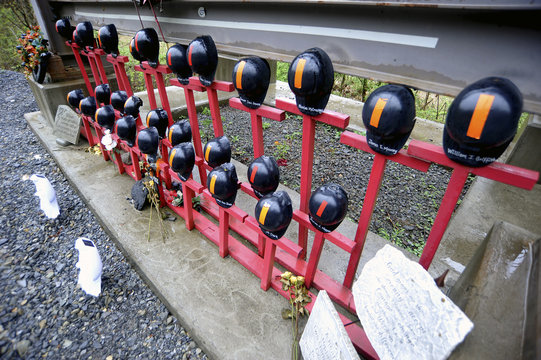 Helmets adorn a memorial made by local residents to honor the 29 West Virginian coal miners that lost their lives on April 5, 2010 in the Upper Big Branch mining disaster, on Route 3 near Whitesville